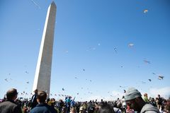 A large crowd of adults and children flying kites at the Kite Festival on the National Mall. WASHINGTON, DC - March 31, 2018: A large crowd of adults and Stock Photography