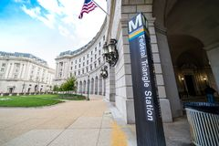 Washington DC - May 9, 2019: Sign post for the Federal Triangle DC Metro Station, allows passengers to catch the blue, silver or. Orange line trains stock image