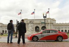 Washington, DC - May 31, 2018: Taxi and people in front of Washington Union Station in Washington, DC. stock photography