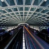 Washington DC Metro Station. Light trail motion blur of commuter train at subway station Stock Photography