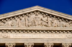 Washington, DC: Pediment of the U. S. Supreme Court. Washington, DC:  Allegorical figures decorate the neo-classical pediment on the west front of the United Royalty Free Stock Photo