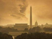 Washington DC skyline under stormy clouds. The Washington DC skyline with the Lincoln Memorial, the Washington Monument and the Capitol under stormy clouds royalty free stock images