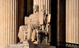 Washington, DC: Supreme Court of the United States. Washington, DC - April 12, 2014: The Authority of Law sculpture by James Fraser on the right side of the of stock image