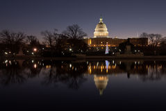 Washington DC United States Capitol Building. The sun rises behind the west front of the United States Capital Building on the first morning of the New Year Stock Images
