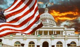 Washington DC, United States landmark. National Capitol building with US flag. Sunset sky over the royalty free stock image