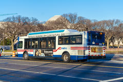 WASHINGTON DC, USA - JANUARY 27, 2006: Public transportation - c. Ity metro bus with advertising printed on the side Royalty Free Stock Images