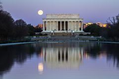 Once in A Blue Moon. WASHINGTON DC/USA - MARCH 31, 2018 - Full Blue Moon setting next to the Lincoln Memorial. Easter is celebrated on the Sunday after the stock photography