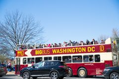 Red double decker tourist bus with the tourists near the Lincoln Memorial. Washington DC, USA - March 31, 2018: Red double decker tourist bus with the tourists Royalty Free Stock Images