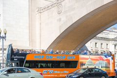 Red double decker tourist bus with the tourists near the Lincoln Memorial. Washington DC, USA - March 31, 2018: Red double decker tourist bus with the tourists Stock Images