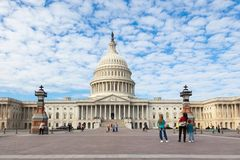 Washington DC, USA: Capitol USA Building at day. People tourists on background of east front at day. White stock image