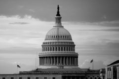 Washington, DC, USA. 08 18 2018. US Capitol dome at the dusk in early morning with two flying flags. b w. royalty free stock images