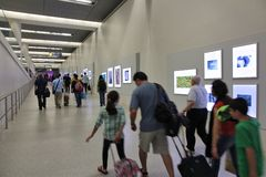 Washington Dulles. WASHINGTON, USA - JUNE 15, 2013: People hurry at Dulles International Airport in Washington, DC, USA. With 10.8 million passengers in 2012 it Royalty Free Stock Photo