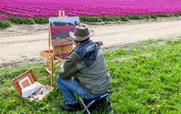 Washington, Etats-Unis - 16 avril 2010 : Artiste masculin sur la peinture sur la toile dans extérieur Plein-air Image stock