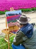 Washington, Etats-Unis - 16 avril 2010 : Artiste masculin sur la peinture sur la toile dans extérieur Plein-air Photo libre de droits
