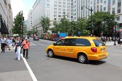 Washington Federal District. WASHINGTON, USA - JUNE 14, 2013: People cross the street in Washington DC. 646 thousand people live in Washington DC (2013) making Stock Photos