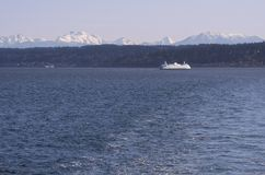 Washington Ferry during the winter. Washington Ferry on the puget sound with snowy cascade mountains in the Royalty Free Stock Photo