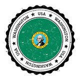 Washington flag badge. Grunge rubber stamp with Washington flag. Vintage travel stamp with circular text, stars and USA state flag inside it. Vector Stock Photography