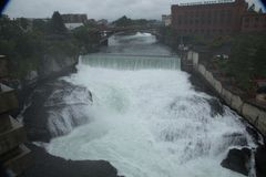 Water power of the Spokane river and waterfall stock image