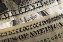 Washington is hiding. George washington lurking behind paper dollar money Stock Photo
