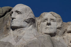 Washington and Jefferson on Mount Rushmore. Two of the four Presidents on Mount Rushmore National Monument; George Washington and Thomas Jefferson Royalty Free Stock Images