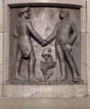 Washington and Kosciuszko. George Washington and Tadeusz Kosciuszko, a bas-relief on the pedestal of the statue of Tadeusz Kosciuszko on Freedom Square in Lodz Royalty Free Stock Photo