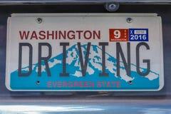 Washington License Plate säger 'körning', Juli 15, 2016 Arkivbild