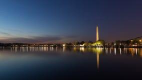 Washington Monument across Tidal Basin during cherry blossom festival, Washington DC. Stock Photos