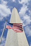 Washington Monument with American flag in front Royalty Free Stock Images