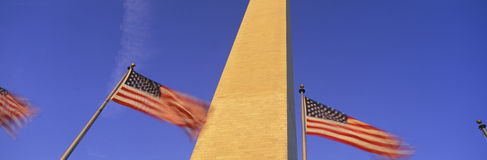 Washington Monument with American flags Royalty Free Stock Image
