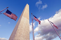 The Washington Monument and American Flags. Dramatic view looking up at the Washington Monument and American Flags Stock Photo