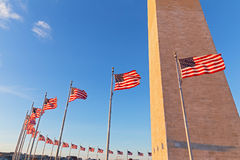Washington Monument and American flags before sunset in US capital. Royalty Free Stock Photography