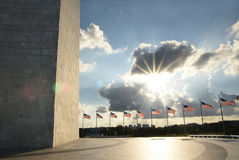 Washington Monument and american flags during sunset Royalty Free Stock Images