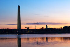 Washington Monument at dawn with the city skyline on background. Royalty Free Stock Images