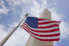 Washington monument and flag Stock Photography