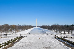 The Washington Monument at The Mall in DC, USA. The Washington Monument and the Reflecting pool after a snow blizzard at the Mall in DC, USA Royalty Free Stock Photography