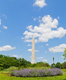 Washington Monument on Memorial Day weekend. Washington Monument against a cloudy blue sky Royalty Free Stock Images