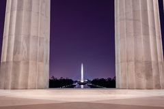 The Washington Monument, Seen From the Lincoln Memorial. A nighttime image of the Washington Monument, as seen from the Lincoln Memorial, in Washington D.C royalty free stock photography