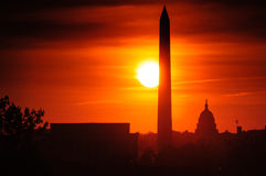 Washington Monument at sunset. Lincoln Memorial and Washington Monument silhouetted with red sunset background, Washington, D.C, U.S.A Royalty Free Stock Photos