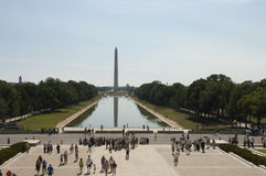 Washington monument with tourists and reflections royalty free stock photography