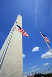 Washington Monument in Washington, DC. With US flags, blue sky on a sunny day. Portrait orientation Stock Image
