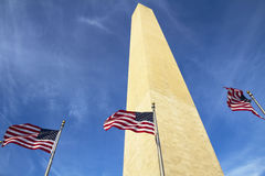 Washington Monument in Washington DC. With flapping american flag Stock Image