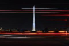 Washington monument in Washington DC. Night photography long exposure of Washington monument with car tails Stock Images