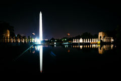 The Washington Monument and World War II Memorial reflecting in. The Reflection Pool at night at the National Mall in Washington, DC Stock Photos
