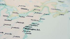 Washington and New York on a Map with Defocus. Washington and New York on a political map of the world. Video defocuses showing and hiding the map stock video