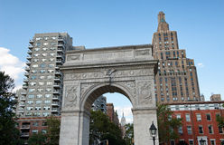 Washington Square Arch on at Edge of NYC Park. Low Angle View of Washington Square Arch on Northern Edge of Washington Square Park with View of Highrise Royalty Free Stock Photos
