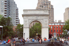 Washington square park. New York, United States - June 9, 2015: People walking and relax in the Washington square park in cloudy summer day Royalty Free Stock Photos