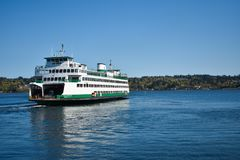 Washington State Ferries Departing. Washington State ferries are one of the most iconic modes of transportation and tourist attractions Royalty Free Stock Image