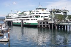 Washington State Ferries at Friday Harbor. On San Juan island in Washington with yachts docked at pier stock images