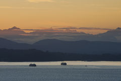 Washington State Ferries and the Olympic Mountains Stock Photography