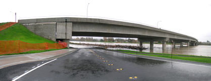 Washington State Flooding - Water Over Roadway. Raging floodwaters of the Skagit River test the integrity of the newly constructed bridge connecting Burlington Stock Images